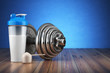 canvas print picture Dumbbell and whey protein shaker. Sports bodybuilding supplement