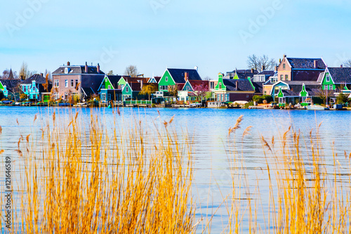 Photo  Row of old dutch green traditional houses in town Zaanse Schans in Netherlands,