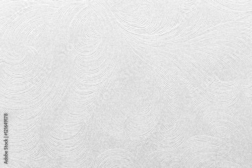 Fototapeta  Embossed white paper with floral pattern.