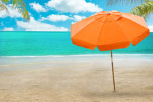 Chaise Lounge And Umbrella On Beach