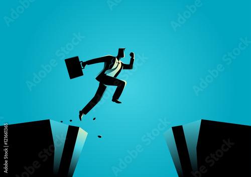 Fotografie, Obraz  Businessman jumps over the ravine