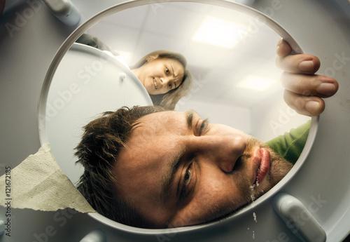 Fotografie, Obraz  Man puking in the toilet bowl