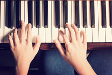 Female Hands Playing Piano With Vintage Look