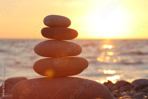 Foto op Plexiglas Stenen in het Zand Zen stones sunset sea peace of mind concept