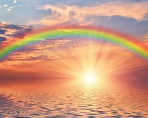 Marine sunset with a rainbow