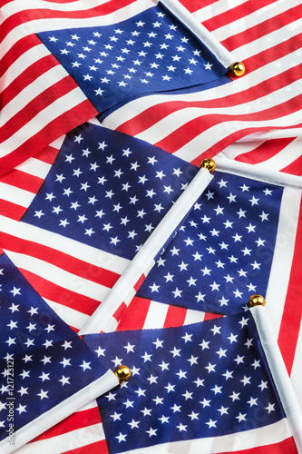 0993676222a small American flags in the background. - Buy this stock photo and ...