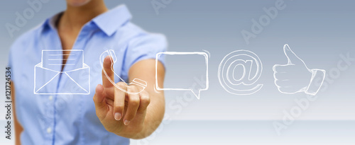 Businesswoman touching manuscript contact icon with his finger