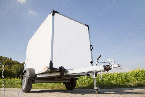 Auto oder Pkw Anhänger mit Anhängekupplung als Kastenanhänger zum Transportieren Canvas Print