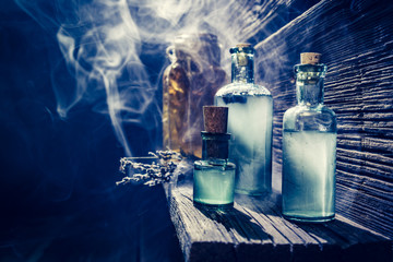 Magical witch lab with blue light and potion for Halloween