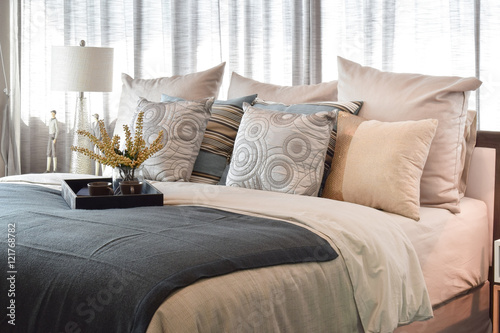 luxury bedroom interior design with striped pillows and decorative tea set on be Wallpaper Mural