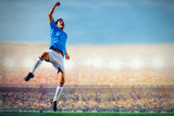 Fototapeta Sport - soccer football player in blue team concept celebrating goal in