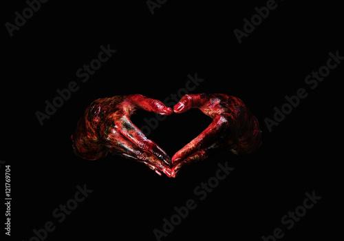 Photo  Halloween theme:Bloody hands , black background, zombie, demon, killer