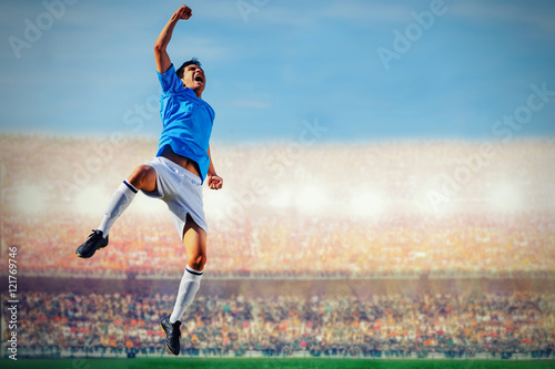 soccer football player in blue team concept celebrating goal in
