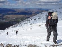 Hiking Through The Snow On Ben...