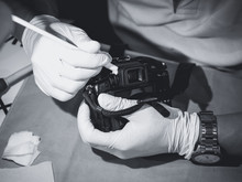 Hand Holding Camera Cleaning L...