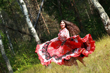 Gypsy Girl In National Dress Dancing In The Forest