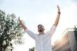 Young Man Raising His Arms