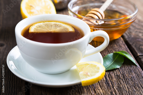 Deurstickers Thee Tea with honey and lemon