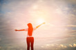 silhouette Young women raise hands up for her success Concept of