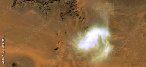 Photo  Allegory alien spacecraft landing in the African desert simulating a sandstorm in the desert, abstract landscapes of deserts of Africa from the air, collection of Abstract Naturalism Munimara