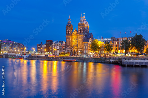 Night panoramic city view of Amsterdam canal, bridge and Basilica of Saint Nicholas, Holland, Netherlands Wallpaper Mural