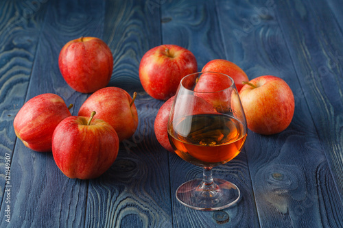 Foto op Canvas Alcohol glass of Calvados Brandy and red apples