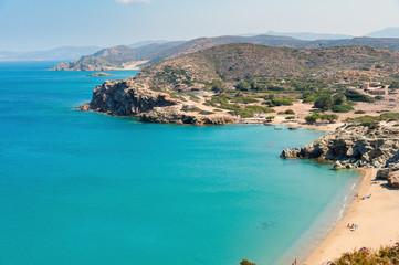 Sandy beach and lagoon with clear blue water at Crete island near Sitia town
