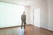 Businessman in unfurnished interior