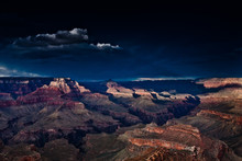 The Grand Canyon With A Dark Stormy Sky At Sunset.