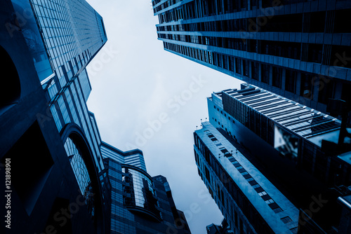 Fototapety, obrazy: low angle view of modern metallic skyscrapers,blue toned,suzhou,china.