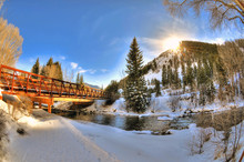 Hiking Trail Bridge Over A River In Aspen, Colorado On A Clear Day During Sunset