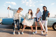 Cheerful young friends dancing together outdoors