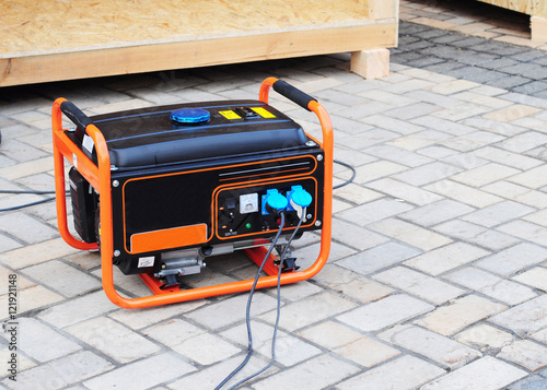 Canvastavla Gasoline Portable Generator on the House Construction Site
