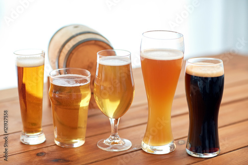 close up of different beers in glasses on table Poster