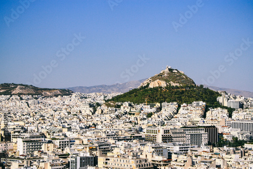 Staande foto Athene Rooftop view of Athens city, taken from the Acropolis, with Mount Lycabettus in the background.