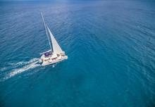 Aerial View Of Catamaran Sailling In Ocean