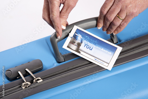 Luggage tag attached to the handle of a suitcase Canvas Print