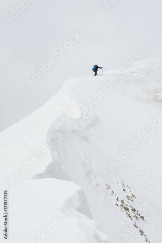 A man climbing Lizard Head Peak, Telluride, Colorado.