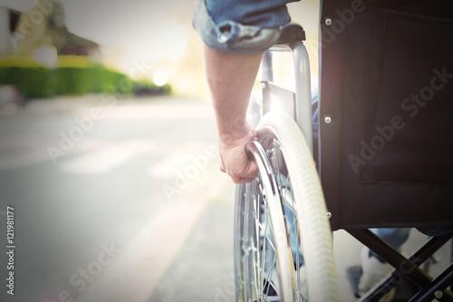 Obraz Disabled man on a wheelchair - fototapety do salonu