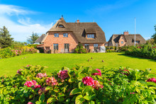 Traditional Houses With Thatched Roofs In Countryside Landscape Of Sylt Island In Kampen Village, Germany
