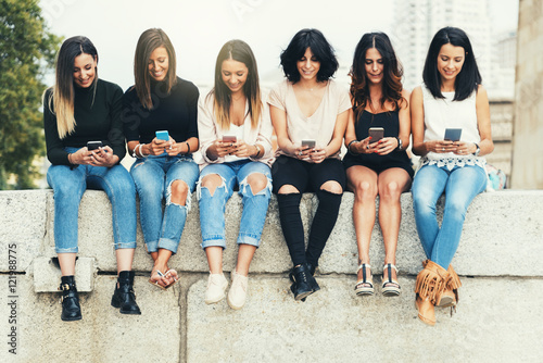 Fotografie, Tablou  Big Group of friends using cellphones.