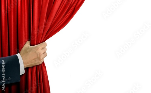 Fotografia  Hand opening stage red curtain over white