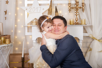 Cute girl hugs her father