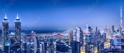 Recess Fitting Dubai Aerial panoramic view of a big futuristic city by night. Business bay, Dubai, United Arab Emirates. Nighttime skyline.