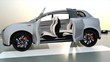 Electric SUV parking on the helipad. The doors opened and front seats rotated to backward. Concept for autonomous vehicle. 3D rendering animation.
