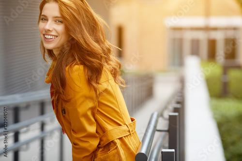 Fotografie, Tablou  beautiful young woman in autumn city