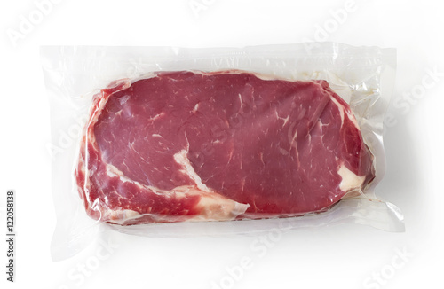 Photo  Fresh beef steak for sous vide cooking, isolated on white, from