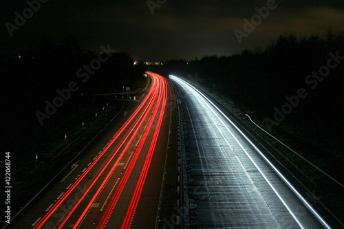In de dag Nacht snelweg High Angle View Of Traffic Light Trails On Highway At Night