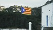 Catalunya flag. Hills and a house in the surrounding.