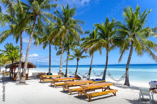 Valokuva  Resort Hammocks and Picnic Tables on Perfect Palm Tree Lined Beach - Panglao, Bo